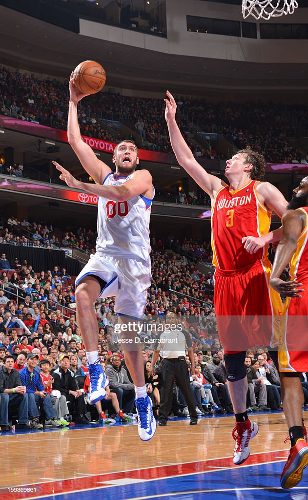 Spencer Hawes #00 of the Philadelphia 76ers shoots against Omer Asik #3 of the Houston Rockets during the game at the Wells Fargo Center on January 12, 2013 in Philadelphia, Pennsylvania.