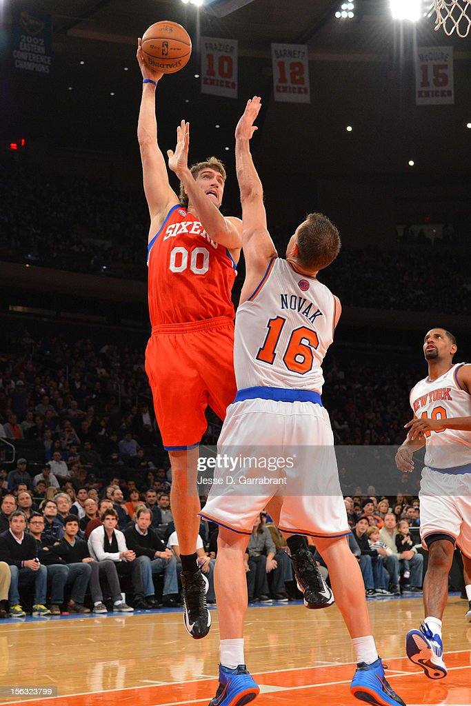 <a gi-track='captionPersonalityLinkClicked' href=/galleries/search?phrase=Spencer+Hawes&family=editorial&specificpeople=3848319 ng-click='$event.stopPropagation()'>Spencer Hawes</a> #00 of the Philadelphia 76ers shoots against <a gi-track='captionPersonalityLinkClicked' href=/galleries/search?phrase=Steve+Novak&family=editorial&specificpeople=693015 ng-click='$event.stopPropagation()'>Steve Novak</a> #16 of the New York Knicks on November 4, 2012 at Madison Square Garden in New York City.