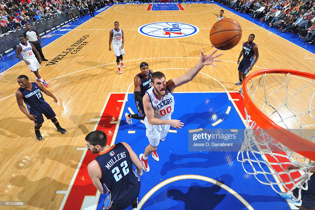 Spencer Hawes #00 of the Philadelphia 76ers shoots against the Charlotte Bobcats during the game at the Wells Fargo Center on February 9, 2013 in Philadelphia, Pennsylvania.