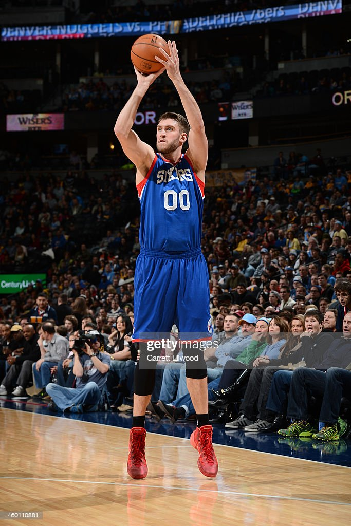 <a gi-track='captionPersonalityLinkClicked' href=/galleries/search?phrase=Spencer+Hawes&family=editorial&specificpeople=3848319 ng-click='$event.stopPropagation()'>Spencer Hawes</a> #00 of the Philadelphia 76ers shoots against the Denver Nuggets on January 1, 2014 at the Pepsi Center in Denver, Colorado.