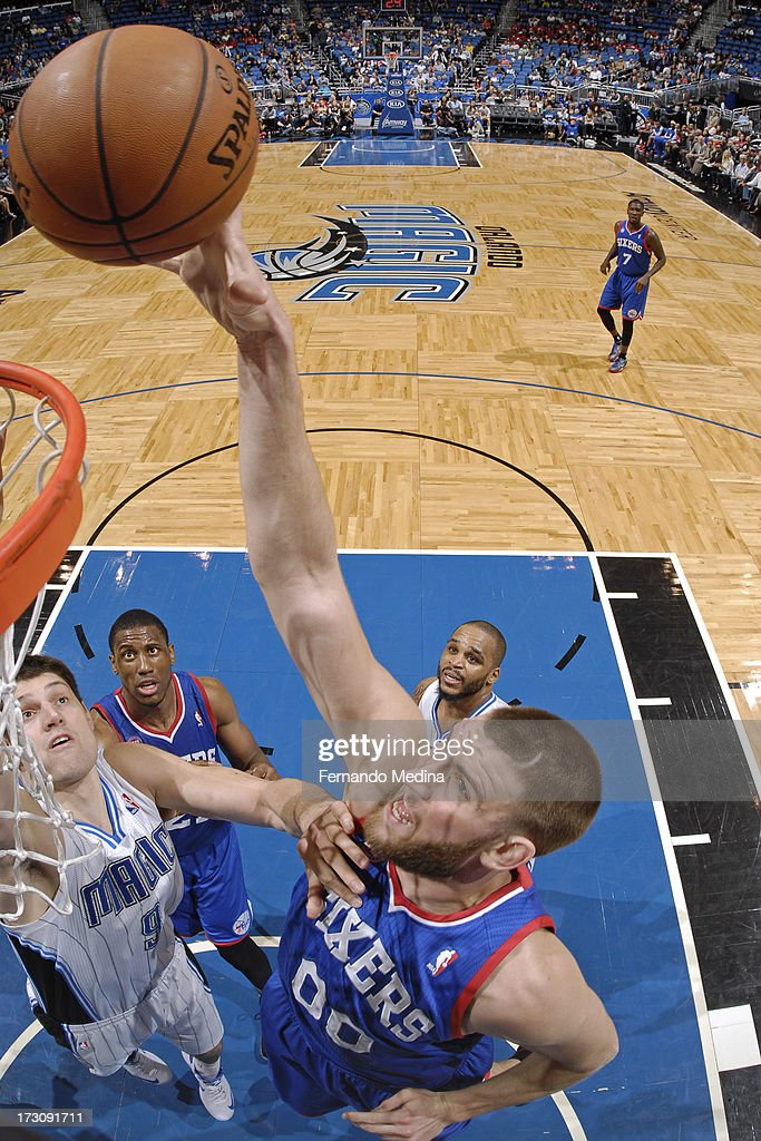 <a gi-track='captionPersonalityLinkClicked' href=/galleries/search?phrase=Spencer+Hawes&family=editorial&specificpeople=3848319 ng-click='$event.stopPropagation()'>Spencer Hawes</a> #00 of the Philadelphia 76ers shoots against the Orlando Magic on March 10, 2013 at Amway Center in Orlando, Florida.
