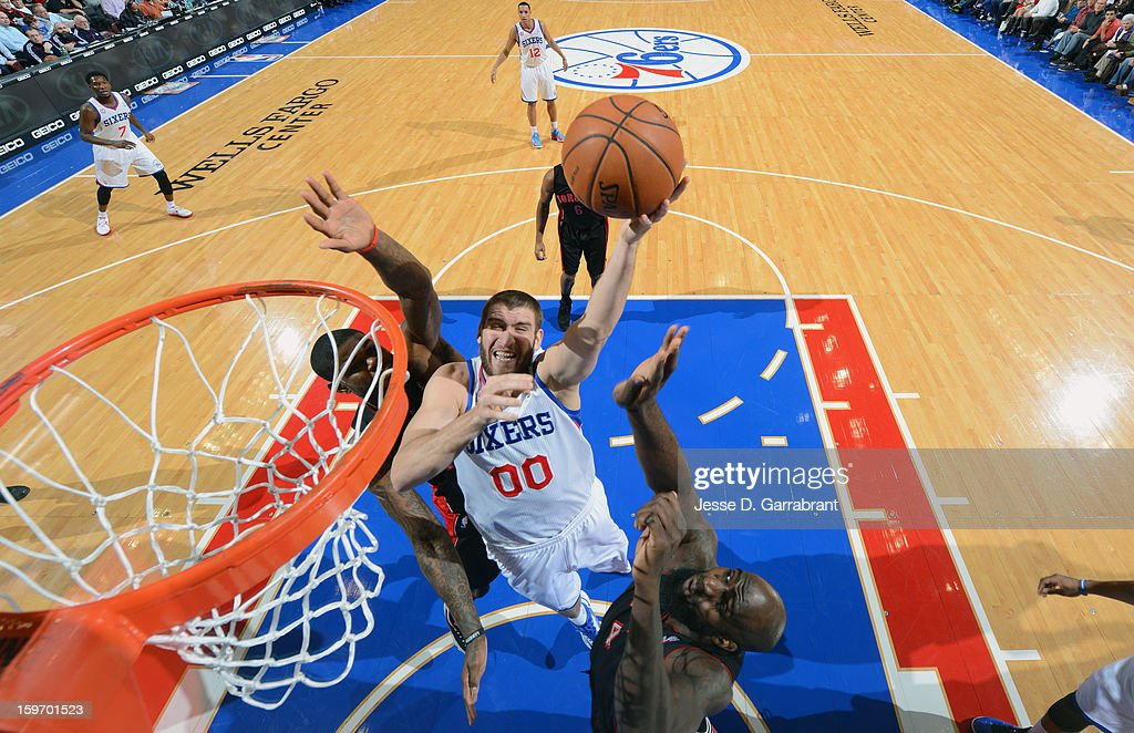 Spencer Hawes #00 of the Philadelphia 76ers shoots against the Toronto Raptors during the game at the Wells Fargo Center on January 18, 2013 in Philadelphia, Pennsylvania.