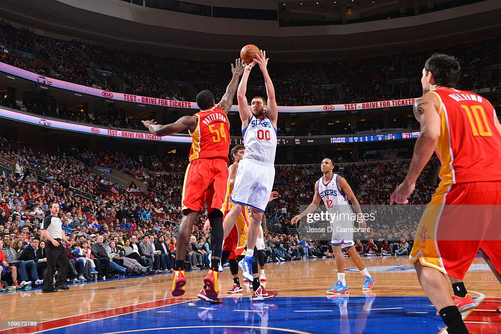 Spencer Hawes #00 of the Philadelphia 76ers takes a shot against the Houston Rockets at the Wells Fargo Center on January 12, 2013 in Philadelphia, Pennsylvania.