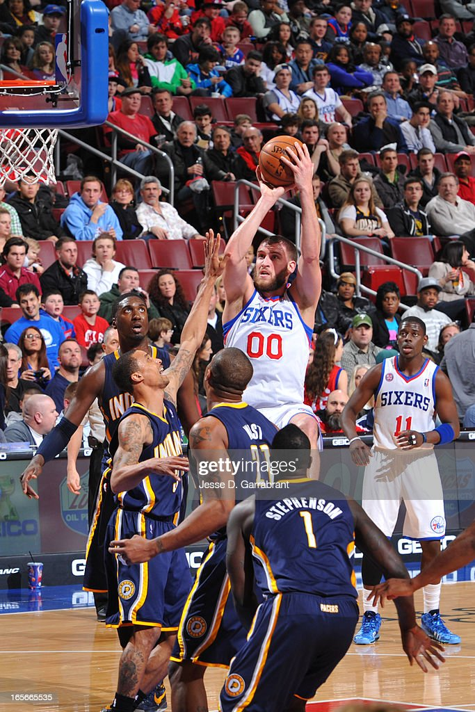 <a gi-track='captionPersonalityLinkClicked' href=/galleries/search?phrase=Spencer+Hawes&family=editorial&specificpeople=3848319 ng-click='$event.stopPropagation()'>Spencer Hawes</a> #00 of the Philadelphia 76ers takes a shot against the Indiana Pacers at the Wells Fargo Center on March 16, 2013 in Philadelphia, Pennsylvania.