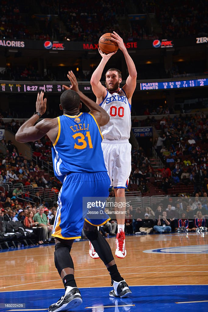 <a gi-track='captionPersonalityLinkClicked' href=/galleries/search?phrase=Spencer+Hawes&family=editorial&specificpeople=3848319 ng-click='$event.stopPropagation()'>Spencer Hawes</a> #00 of the Philadelphia 76ers takes a shot against the Golden State Warriors on March 2, 2013 at the Wells Fargo Center in Philadelphia, Pennsylvania.