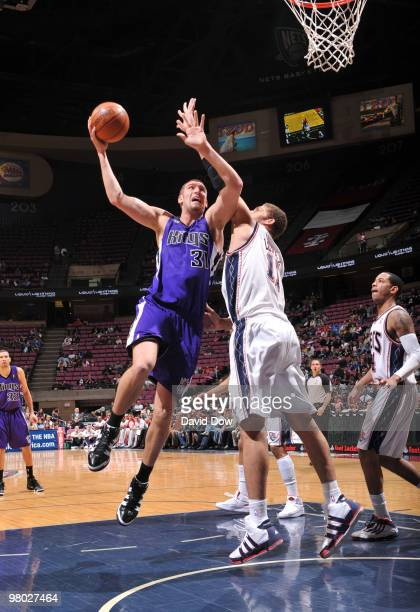 Spencer Hawes of the Sacramento Kings shoots against Brook Lopez of the New Jersey Nets during the game on March 24 2010 at the Izod Center in East...