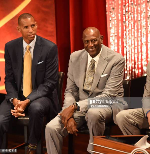 Spencer Haywood and Reggie Miller look on as Inductee George McGinnis speaks during the 2017 Basketball Hall of Fame Enshrinement Ceremony on...