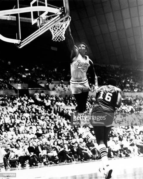 Spencer Haywood of the Seattle SuperSonics goes up for a slam dunk during the 1970 NBA game against Bob Lanier of the Detroit Pistons at the Seattle...
