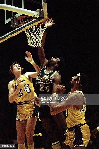 Spencer Haywood of the Seattle Supersonics goes up to rebound tip in against the Los Angeles Lakers during the NBA game circa 1970 at the Forum in...