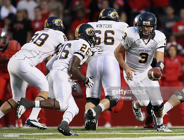 Spencer Keith of the Kent State Golden Flashes hands the ball off to Dri Archer at High Point Solutions Stadium on October 27 2012 in Piscataway New...