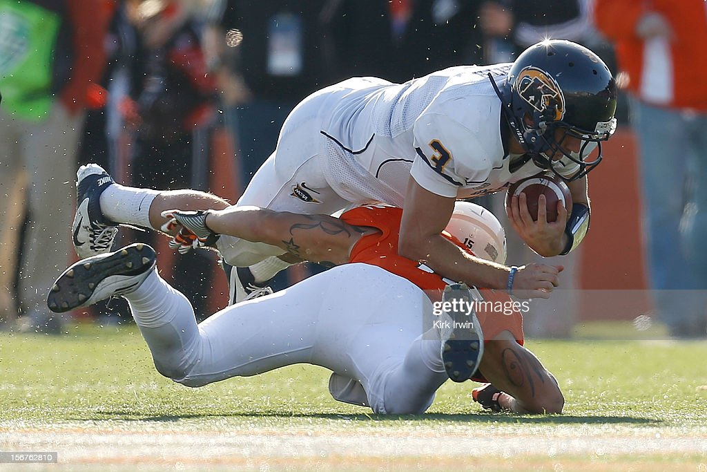 Spencer Keith #3 of the Kent State Golden Flashes is tackled by Ryland Ward #15 of the Bowling Green Falcons on November 17, 2012 at Doyt Perry Stadium in Bowling Green, Ohio.