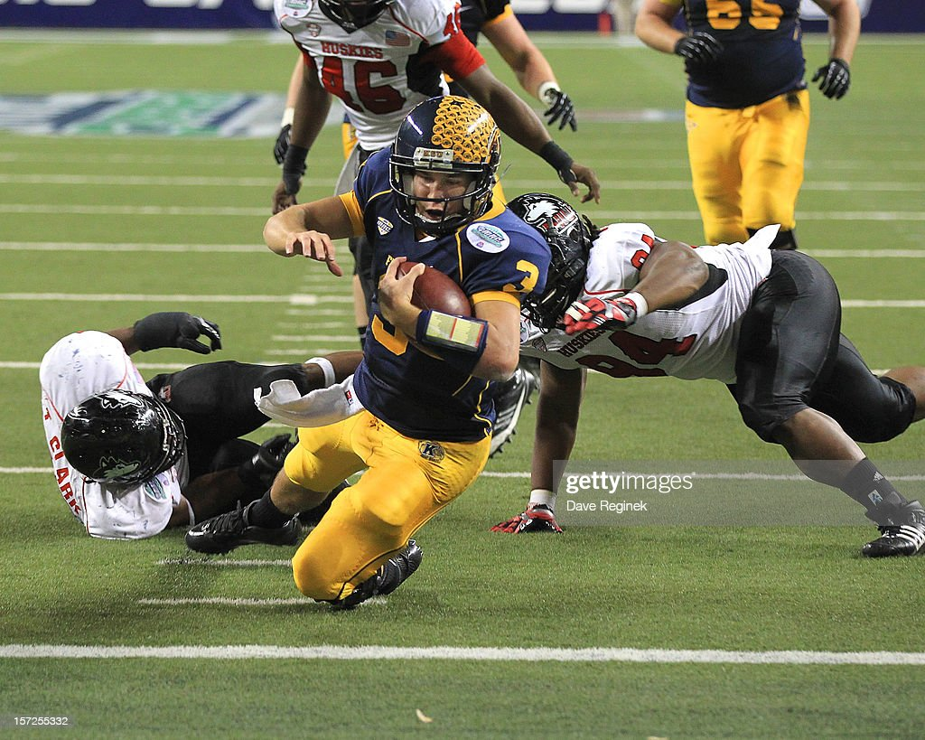 Spencer Keith #3 of the Kent State Golden Flashes scores a second-half touchdown against the Northern Illinois Huskies during the Mid-American Conference Championship game at Ford Field on November 30, 2012 in Detroit, Michigan. Illinois won 44-37