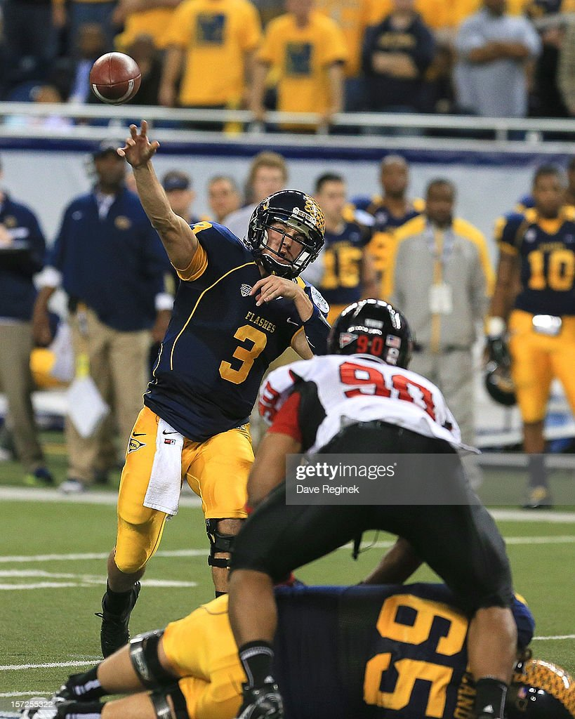 Spencer Keith #3 of the Kent State Golden Flashes throws the football over Alan Baxter #90 of the Northern Illinois Huskies during the Mid-American Conference Championship game at Ford Field on November 30, 2012 in Detroit, Michigan. Illinois won 44-37