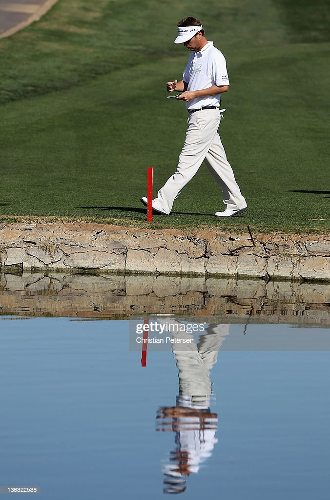 <a gi-track='captionPersonalityLinkClicked' href=/galleries/search?phrase=Spencer+Levin&family=editorial&specificpeople=2145900 ng-click='$event.stopPropagation()'>Spencer Levin</a> walks from the 12th hole green during the final round of the Waste Management Phoenix Open at TPC Scottsdale on February 5, 2012 in Scottsdale, Arizona.