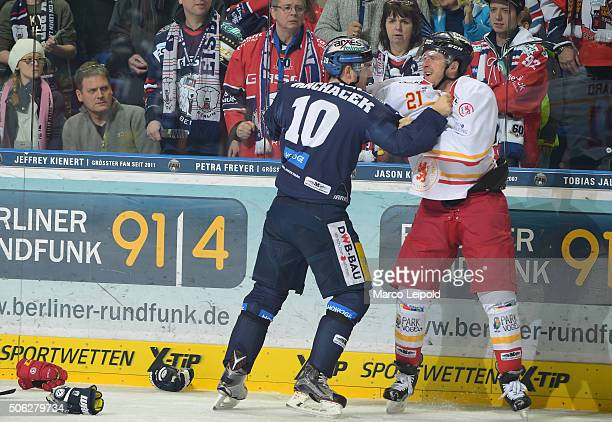 Spencer Machacek of the Eisbaeren Berlin and Chris Minard of the Duesseldorfer EG during the DEL game between the Eisbaeren Berlin and Duesseldorfer...