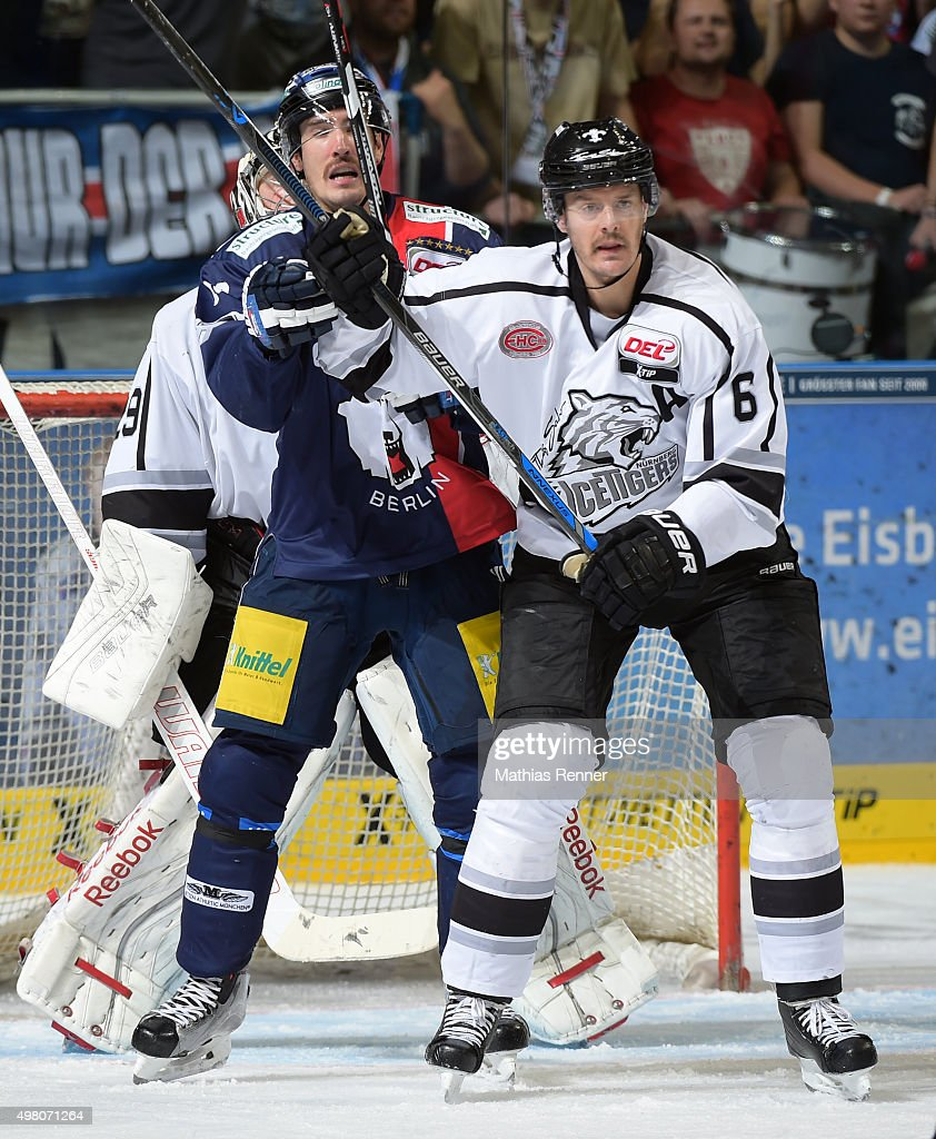 Spencer Machacek of the Eisbaeren Berlin and Kurtis Foster of the Thomas Sabo Ice Tigers Nuernberg during the game between the Eisbaeren Berlin and...