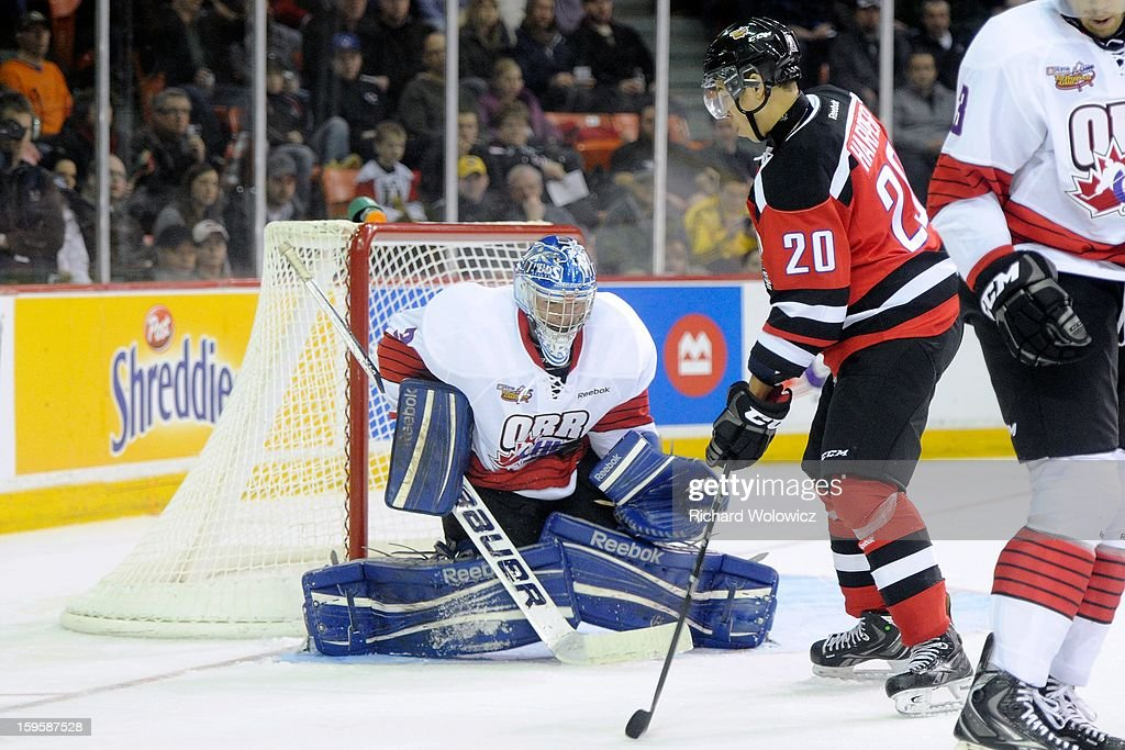 Spencer Martin #30 of Team Orr stops the puck in front of Stephen Harper #20 of Team Cherry during the CHL Top Prospects game at the Halifax Metro Centre on January 16, 2013 in Halifax, Nova Scotia, Canada.