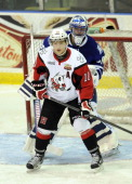 Spencer Martin of the Mississauga Steelheads is screened by Anthony DiFruscia of the Niagara IceDogs during game action on February 23 2014 at the...