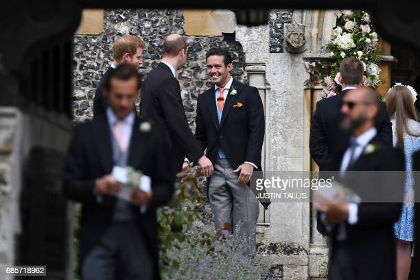 Spencer Matthews brother of the groom greets Britain's Prince William Duke of Cambridge and Britain's Prince Harry outside the church ahead of the...