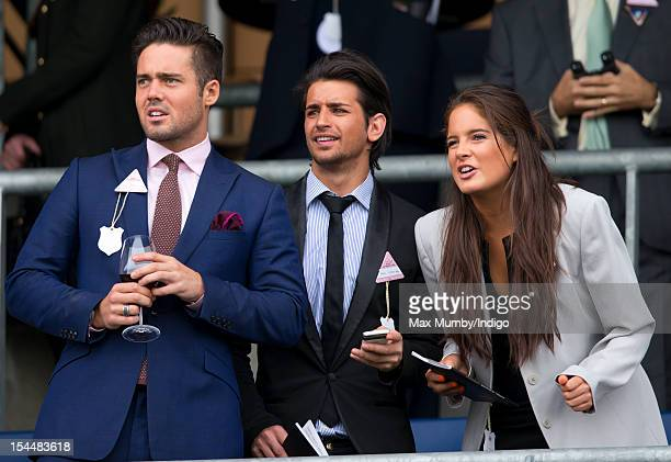 Spencer Matthews Ollie Locke and Binky Felstead watch the racing as they attend the QIPCO British Champions Day meet at Ascot Racecourse on October...