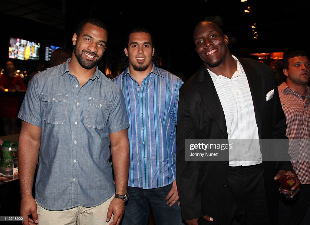 Spencer Paysinger, Justin Trattou and Kevin Boothe attend the NY Giants Justin Tuck 4th Annual celebrity billiards tournament at Slate NYC on May 31, 2012 in New York City.