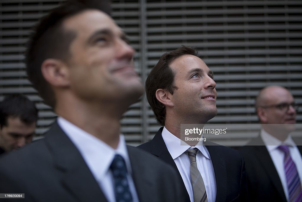 Spencer Rascoff, chief executive officer of Zillow Inc., center, and Michael Smith, chief executive officer of StreetEasy, left, look up at the front of the Nasdaq MarketSite in New York, U.S., on Monday, Aug. 19, 2013. Zillow Inc., operator of the largest U.S. real-estate website, agreed to acquire StreetEasy for $50 million in cash to expand its coverage of the New York market. Photographer: Scott Eells/Bloomberg via Getty Images