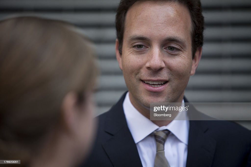 Spencer Rascoff, chief executive officer of Zillow Inc., center, chats in front of the Nasdaq MarketSite in New York, U.S., on Monday, Aug. 19, 2013. Zillow Inc., operator of the largest U.S. real-estate website, agreed to acquire StreetEasy for $50 million in cash to expand its coverage of the New York market. Photographer: Scott Eells/Bloomberg via Getty Images