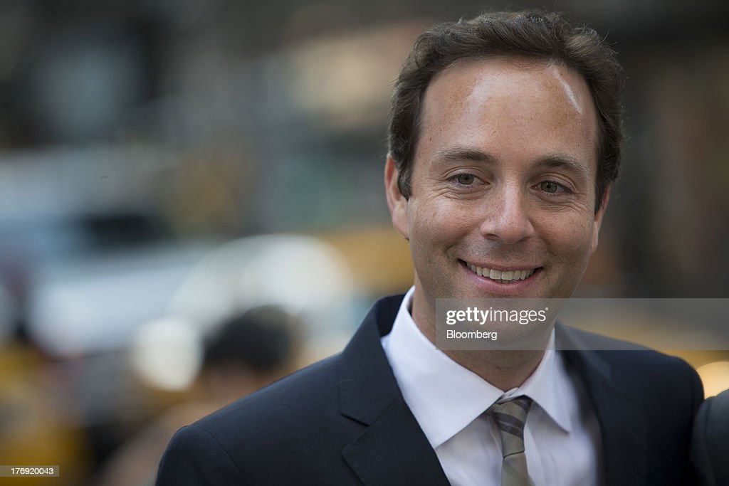 Spencer Rascoff, chief executive officer of Zillow Inc., center, stands in front of the Nasdaq MarketSite in New York, U.S., on Monday, Aug. 19, 2013. Zillow Inc., operator of the largest U.S. real-estate website, agreed to acquire StreetEasy for $50 million in cash to expand its coverage of the New York market. Photographer: Scott Eells/Bloomberg via Getty Images