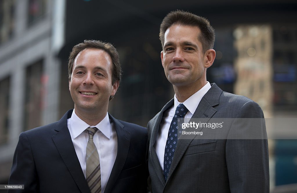 Spencer Rascoff, chief executive officer of Zillow Inc., left, stands for a photograph with Michael Smith, chief executive officer of StreetEasy, in front of the Nasdaq MarketSite in New York, U.S., on Monday, Aug. 19, 2013. Zillow Inc., operator of the largest U.S. real-estate website, agreed to acquire StreetEasy for $50 million in cash to expand its coverage of the New York market. Photographer: Scott Eells/Bloomberg via Getty Images
