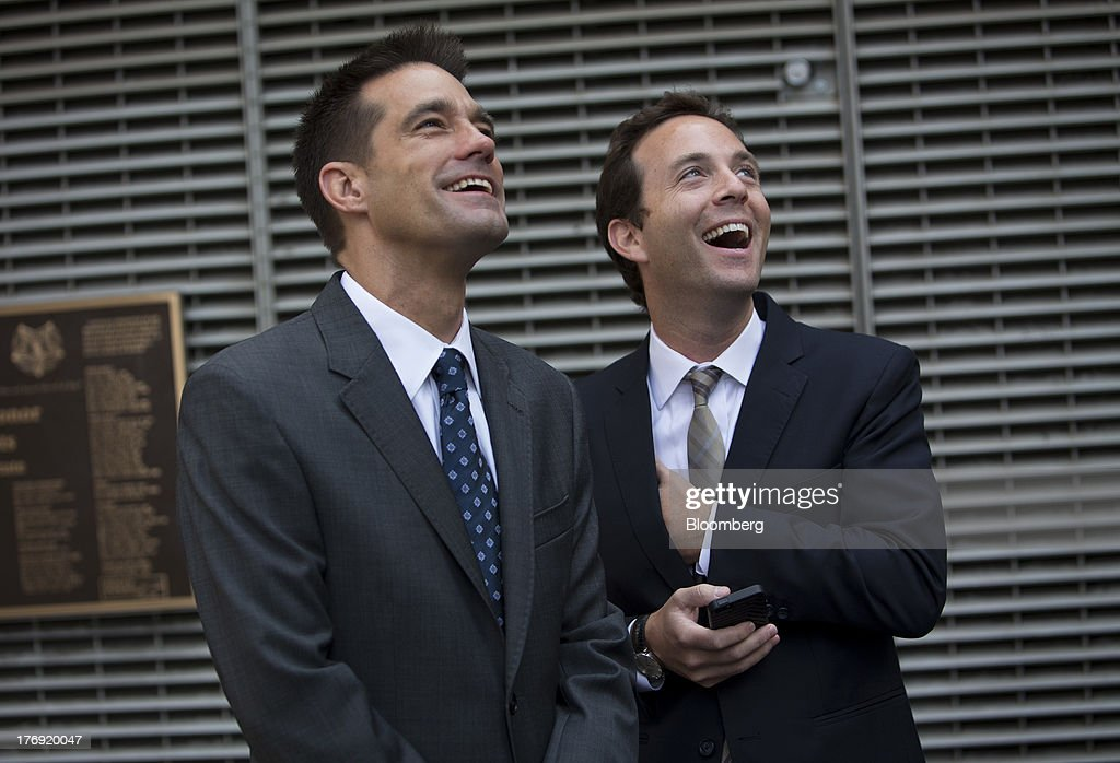 Spencer Rascoff, chief executive officer of Zillow Inc., right, stands with Michael Smith, chief executive officer of StreetEasy, in front of the Nasdaq MarketSite in New York, U.S., on Monday, Aug. 19, 2013. Zillow Inc., operator of the largest U.S. real-estate website, agreed to acquire StreetEasy for $50 million in cash to expand its coverage of the New York market. Photographer: Scott Eells/Bloomberg via Getty Images