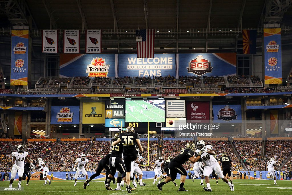 Spencer Roth of the Baylor Bears punts the ball against the UCF Knights during the Tostitos Fiesta Bowl at University of Phoenix Stadium on January 1...