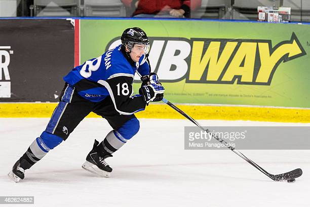 Spencer Smallman of the Saint John Sea Dogs skates with the puck during the QMJHL game against the BlainvilleBoisbriand Armada at the Centre...