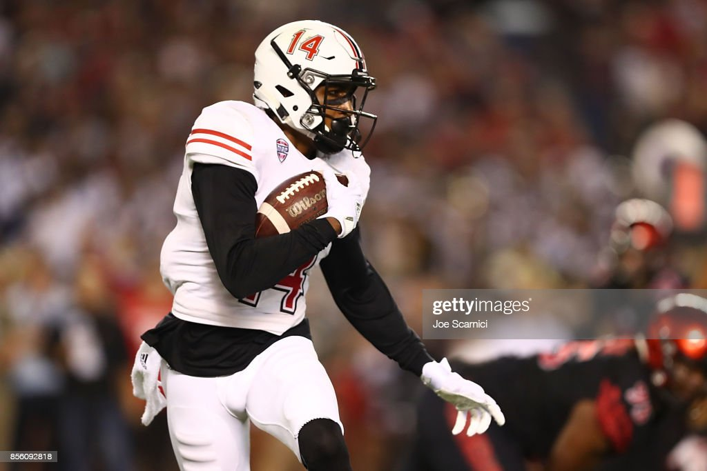 Spencer Tears #14 of the Northern Illinois Huskies runs the ball in the first quarter during the Northern Illinois v San Diego State game at Qualcomm Stadium on September 30, 2017 in San Diego, California.