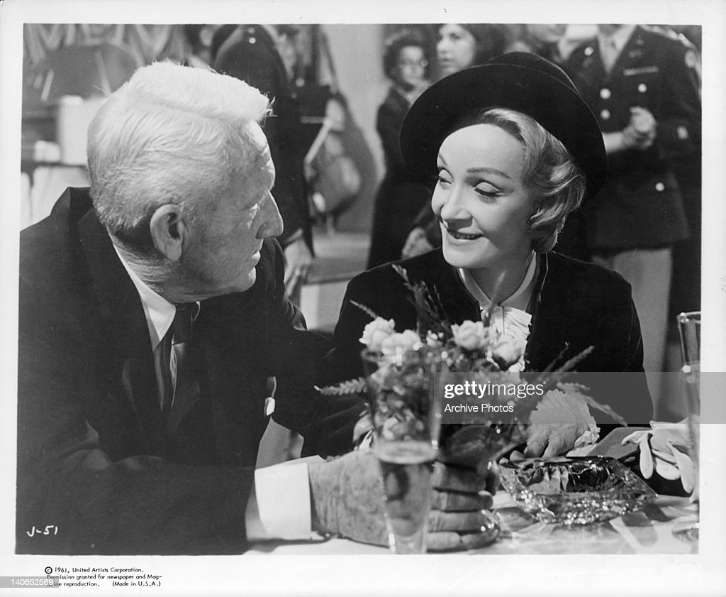 Spencer Tracy sitting together Marlene Dietrich in a scene from the film 'Judgement At Nuremberg', 1961.