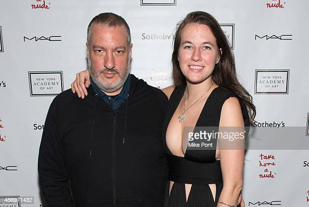 Spencer Tunick and Natalie White attend the 2014 Take Home A Nude Event at Sotheby's on October 9 2014 in New York City