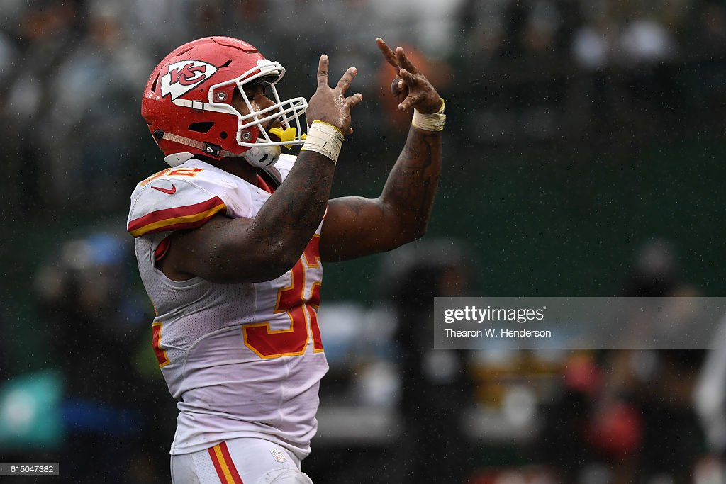 Spencer Ware #32 of the Kansas City Chiefs celebrates after a two-yard touchdown against the Oakland Raiders during their NFL game at Oakland-Alameda County Coliseum on October 16, 2016 in Oakland, California.