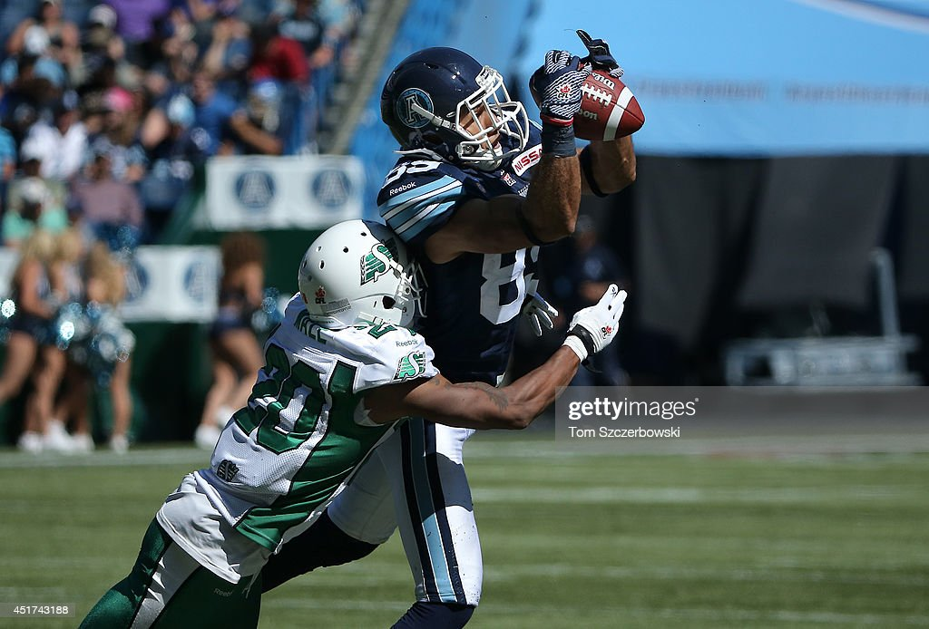 Spencer Watt #89 of the Toronto Argonauts is tackled after making the catch during a CFL game against the Saskatchewan Roughriders on July 5, 2014 at Rogers Centre in Toronto, Ontario, Canada.
