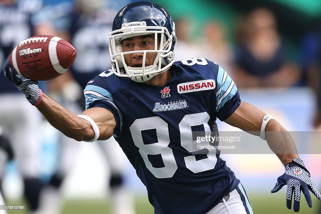 Spencer Watt #89 of the Toronto Argonauts warms up before playing in CFL game action against the Saskatchewan Roughriders on July 11, 2013 at Rogers Centre in Toronto, Ontario, Canada.