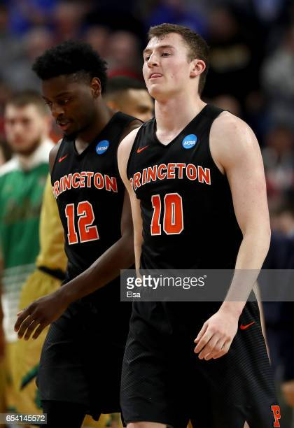 Spencer Weisz and Myles Stephens of the Princeton Tigers reacts after being defeated by the Notre Dame Fighting Irish with a score of 60 to 58 during...