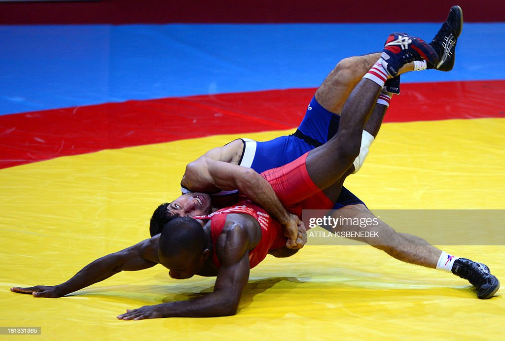 US Spenser Thomas Mango and Armenia's Roman Amoyan fight during the men's GrecoRoman style 55 kg category for bronze in the FILA World Wrestling...
