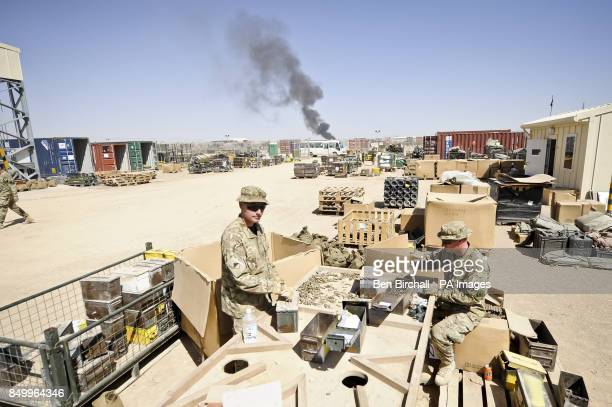 Spent brass ammunition cartridges and links from ammunition belts are sorted by hand and certified free from explosives after being collected from...
