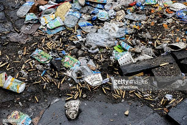 Spent bullet shells litter the streets of Sur district on December 30 2015 in the mainly Kurdish city of Diyarbakir after a curfew was partially...