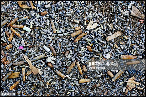 Spent casings and cigarettes litter the ground at the local shooting range that Cho SeungHui used for target practice before he shot 32 people and...