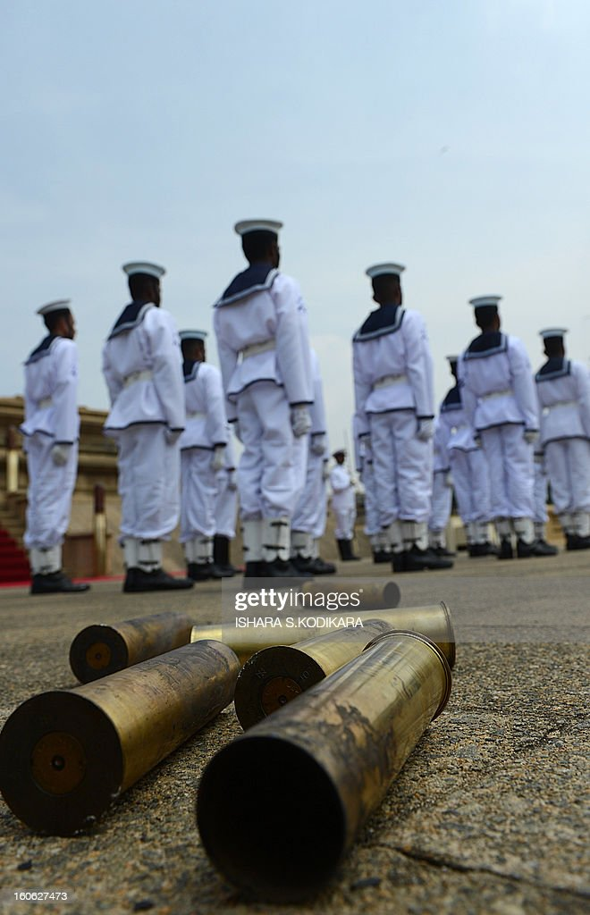 Spent shells are pictured after Sri Lankan Navy personnel fired a 21-gun salute on the capital's seafront Galle Face promenade to mark the island nation's 65th Independence Day in Colombo on February 4, 2013. Sri Lanka marked its freedom anniversary with a thinly veiled denunciation of Western moves to pass a new resolution against the island at the UN Human Rights Council. AFP PHOTO/Ishara S