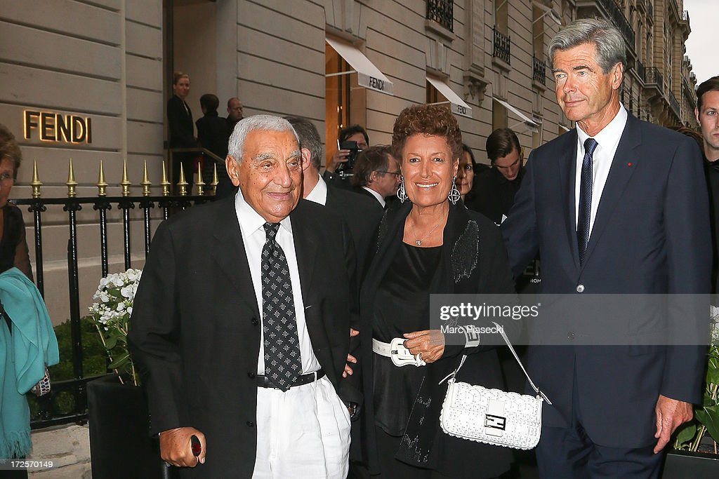 Speroni Candido, <a gi-track='captionPersonalityLinkClicked' href=/galleries/search?phrase=Carla+Fendi&family=editorial&specificpeople=676894 ng-click='$event.stopPropagation()'>Carla Fendi</a> and guest arrive to attend the 'The Glory of Water' Karl Lagerfeld's exhibition at FENDI store on Avenue Montaigne on July 3, 2013 in Paris, France.