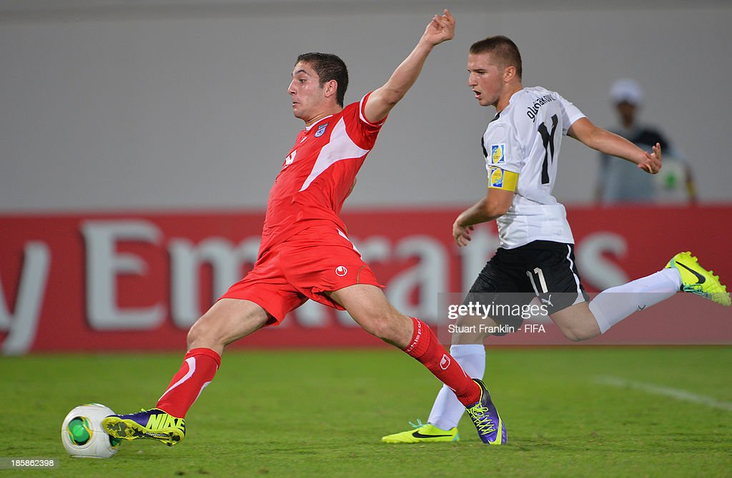 SPetar Gluhakovic of Austria challenges for the ball with Amir Mazloum of Iran during the FIFA U 17 World Cup group E match between Austria and Iran at Khalifa Bin Zayed Stadium on October 25, 2013 in Al Ain, United Arab Emirates.