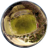 Spherical panorama from composite aerial photos of a football field in a village in the heath, made with drone