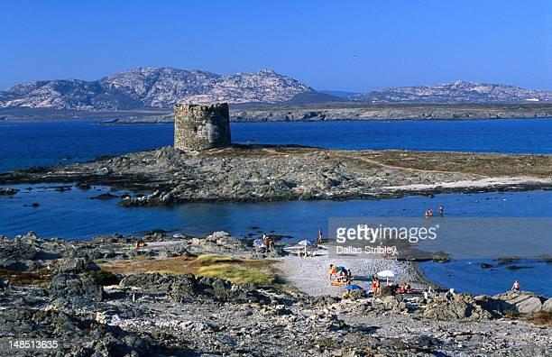 Spiaggia di Pelosa, the Torre Pelosa and the distant Asinara Island.