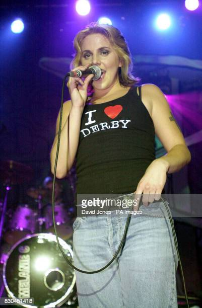 Spice Girl and solo singer Mel C wearing an 'I Love Derby' vest performing on stage at the start of her solo World tour at the Assembly rooms in Derby
