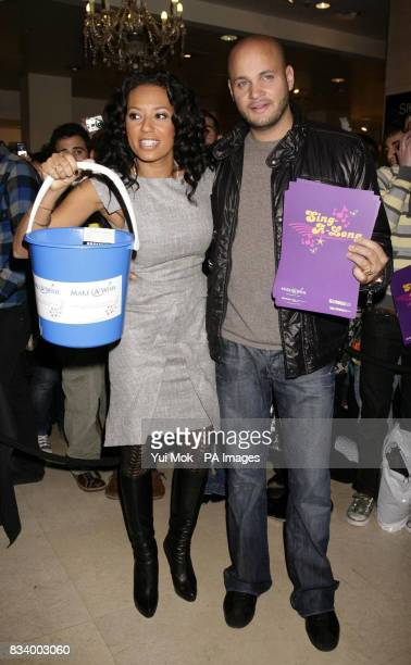 Spice Girl Mel B and her husband Stephen Belafonte arrive to meet shoppers in Selfridges before Mel sang Christmas carols in store to help raise...
